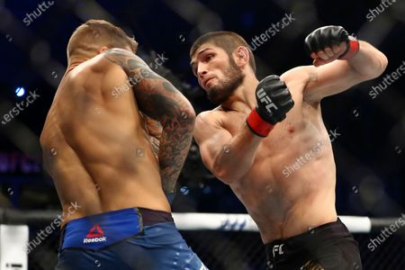 """Russian UFC fighter Khabib Nurmagomedov, right, fights with UFC fighter Dustin Poirier, of Lafayette, La., during lightweight title mixed martial arts bout at UFC 242 in Yas Mall in Abu Dhabi, United Arab Emirates. Nurmagomedov says he won't leave quarantine in Russia to fight, dealing another blow to UFC President Dana White's determination to hold UFC 249 in two weeks amid the coronavirus pandemic. Nurmagomedov made his announcement, on Instagram, telling the mixed martial arts world to """"take care of yourself and put yourself in my shoes"""