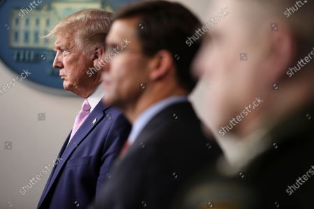 United States President Donald Trump listens during the daily briefing on the novel coronavirus, COVID-19, in the Brady Press Briefing Room of the White House. Next to Trump, US Secretary of Defense Dr. Mark Esper, center, and US Army General Mark A. Milley, Chairman of the Joint Chiefs of Staff, right.