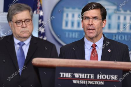 United States Secretary of Defense Dr. Mark Esper speaks as US Attorney General William Barr listens, during the daily briefing on the novel coronavirus, COVID-19, in the Brady Press Briefing Room of the White House.