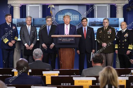 United States President Donald Trump speaks during a press conference in the Brady Press Briefing Room of the White House. Pictured behind the President, from left to right: Admiral Karl L. Schiltz, Commandant of the US Coast Guard; United States National Security Advisor Robert C. O'Brien; US Attorney General William Barr ; US Secretary of Defense Dr. Mark Esper ; US Army General Mark A. Milley, Chairman of the Joint Chiefs of Staff; and United States Navy Admiral Michael Gilday, Chief of Naval Operations.