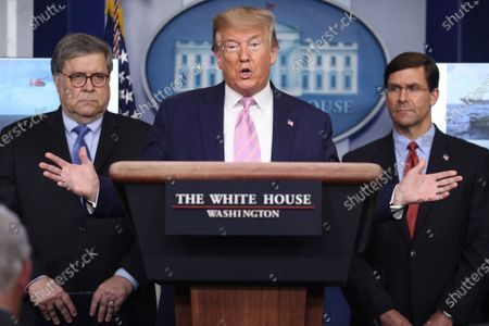 United States President Donald Trump speaks during a press conference with members of the coronavirus task force in the Brady Press Briefing Room of the White House. Standing behind the President are US Attorney General William Barr, left, and US Secretary of Defense Dr. Mark Esper, right.