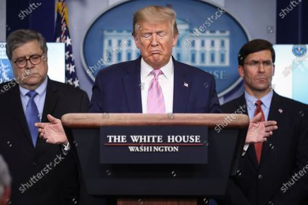 United States President Donald Trump speaks during a press conference in the Brady Press Briefing Room of the White House. At Left is US Attorney General William Barr and at right is US Secretary of Defense Dr. Mark Esper.