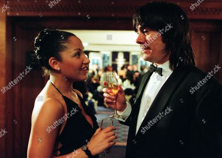 Stock Image of Ep 3137 Wednesday 20th March 2002 Cain is up to his usual tricks at the awards ceremony as he introduces himself as a businessman, flirting with Latisha and proceeds to order champagne. With Cain Dingle, as played by Jeff Hordley ; Latisha Daggert, as played by Danielle Henry.