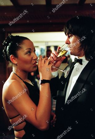 Stock Photo of Ep 3137 Wednesday 20th March 2002 Cain is up to his usual tricks at the awards ceremony as he introduces himself as a businessman, flirting with Latisha and proceeds to order champagne. With Cain Dingle, as played by Jeff Hordley ; Latisha Daggert, as played by Danielle Henry.