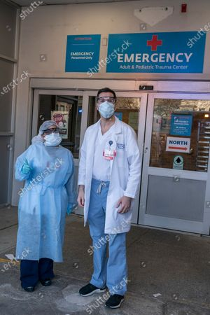 Stock Picture of Frontline hospital workers Gaetana Marra and Steven Tyler pose in front of emergency room at Maimonides Medical Center in Brooklyn where patients for COVID-19 have been treated