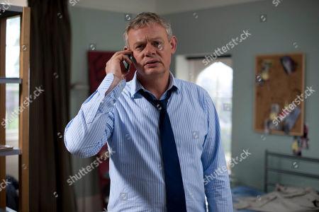 Martin Clunes as Ben.
