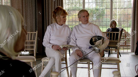 Stock Image of Ep 10050 Friday 17th April 2020 Having trounced Ken Barlow, as played by William Roache, in the fencing match, smug Charles suggests they do it again next week. Ken's fuming but Norris Cole, as played by Malcolm Hebden, reveals that whilst they were jousting, he rifled through Charles's sports bag and found the Stillwaters' Rule Book. Ken, Claudia Colby, as played by Rula Lenska, and Norris peruse the Rule Book and discover Charles has been ripping off the residents left, right and centre.