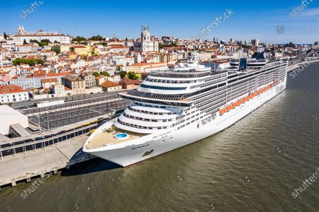(EDITOR'S NOTE: Image taken with a drone) The MSC Fantasia Cruise, remains docked at Lisbon's cruise terminal during the state of emergency. The Portuguese government declared a state of emergency across the country due to the Covid-19 pandemic. Appealing to all Portuguese people to stay at home, to avoid the spread of the virus. Leaving the City of Lisbon partially deserted.