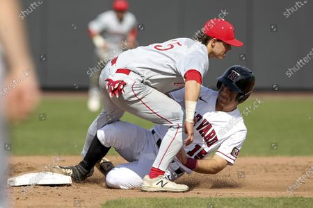 Harvard's Jake Suddleson, right, slides safely into second base ahead of the tag by Cornell's Matt Collins, left, during an NCAA college baseball game in Boston. The Ivy League has decided not to allow its spring-sport athletes who had their seasons shortened by the coronavirus pandemic to have an additional year of eligibility, despite the NCAA granting that option earlier this week. The move, which was announced, was consistent for the Ivy League, which hasn't allowed athletes who received medical redshirts to play for a fifth year
