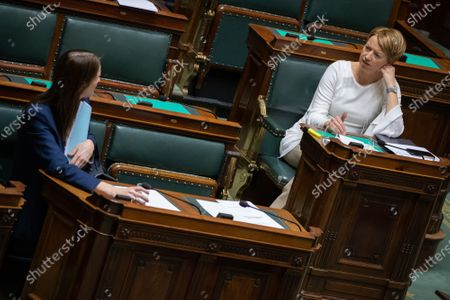 Belgian Prime Minister Sophie Wilmes and cdH's Catherine Fonck pictured during a plenary session of the chamber at the federal parliament. Due to the restrictive measures concerning the corona virus, only the chiefs of the party groups will be present during the discussions.