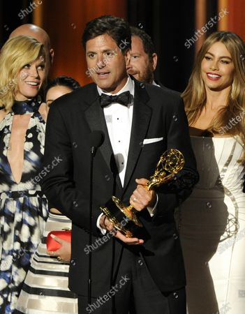 """Show creator Steven Levitan, center, accepting the award for outstanding comedy series for """"Modern Family"""" at the 66th Annual Primetime Emmy Awards in Los Angeles. Looking are cast members Julie Bowen, left, and Sofía Vergara. The popular comedy series, which earned five best comedy Emmy Awards, ends its 11-season run with a two-hour finale on Wednesday"""