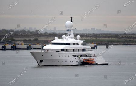 Superyacht Ilona is pictured cruising the River Thames on her way to the London International Cruise Terminal and passing the cruise ship Magellan, laid up because of the Coronavitus pandemic. The 82m super yacht launched in 2003 is owned by Australian businessman Frank Lowe. The elegant yacht is equipped with a helicopter landing pad located above the bridge deck and the aft deck has a 10m swimming pool.