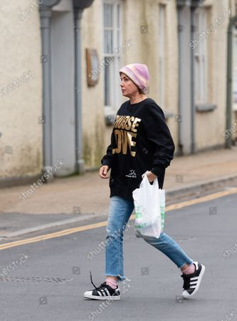 Sadie Frost pops into the Pharmacy and the Bakers for some essential provisions as she and her family quarantine in the Cotswolds.