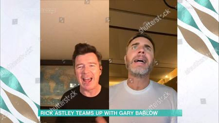 Rick Astley performing with Gary Barlow