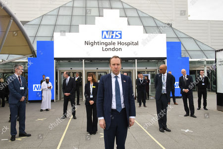 Health Secretary Matt Hancock and NHS staff stand on marks on the ground, put in place to ensure social distancing guidelines are adhered to, at the opening of the NHS Nightingale Hospital at the ExCel centre in London, a temporary hospital with 4000 beds which has been set up for the treatment of Covid-19 patients. Split into more than 80 wards containing 42 beds each, the facility will be used to treat Covid-19 patients who have been transferred from other intensive care units across London.