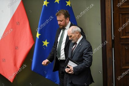 Polish Health Minister Lukasz Szumowski (L) and Former Polish Minister of Defence Antoni Macierewicz (R) during the parliamentary debate on government's draft law on special solutions to support operational programs in connection with the coronavirus disease COVID-19 in Warsaw, Poland, 03 April 2020.
