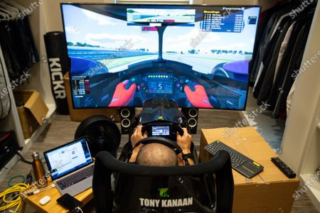 IndyCar driver Tony Kanaan, of Brazil, uses a racing simulator in his home in Indianapolis to practice for a virtual racing event. As Robert Wickens fought his way back from a spinal cord injury, he kept dreaming about the day he could run against his old racing buddies. The promising Canadian driver believes he'll take his biggest step yet by making his debut in the IndyCar iRacing Challenge - a virtual race being held, on the Barber Motorsports Track in Alabama