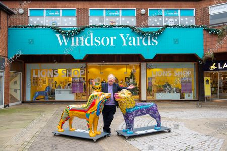 Stock Photo of Comedian Tim Brooke-Taylor OBE poses outside a pop up shop in Windsor Yards shopping centre with some painted fibre glass lions following their display around the streets of Windsor. A number of lions were to be sold in a charity auction
