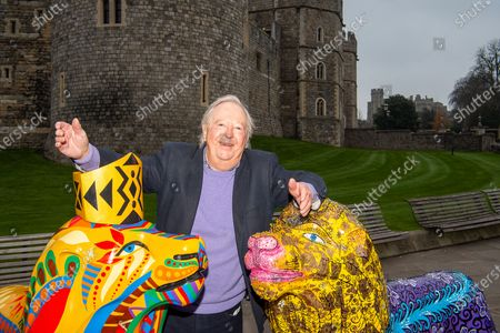 Comedian Tim Brooke-Taylor OBE poses with outside Windsor Castle with some painted fibre glass lions following their display around the streets of Windsor. A number of lions were to be sold in a charity auction