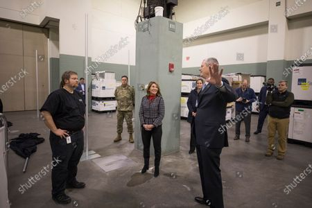 Massachusetts Governor Charlie Baker (R)  and Lt. Governor Karyn Polito (C) speak with Dr. John Broach (L) of UMass Medical School as they tour the medical field hospital erected by the Massachusetts National Guard at the DCU Center in Worcester, Massachusetts, USA, 01 April 2020, for the expected influx of patients due to the COVID-19 pandemic.