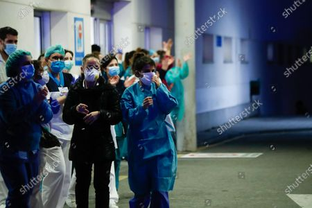 Illustration, Medical Staff and Police Corps thank each other for the work they do at Infanta Elena Hospital of Valdemoro, Madrid, during the second week after the Government declared the state of alarm in Spain and recommended people to stay at home to fight coronavirus COVID-19 on March 27, 2020 in Valdemoro, Madrid, Spain