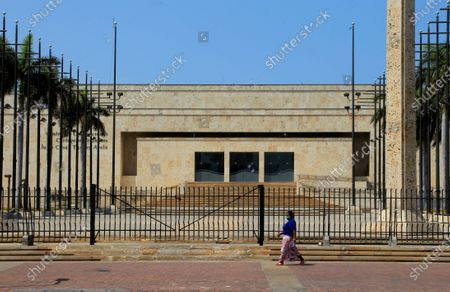 A woman walks in front of the empty Julio Cesar Turbay Ayala Convention Center in Cartagena, the main tourist port in Colombia, 03 April 2020 (Issued 04 April 2020). The streets of the historic center and the beaches of Cartagena de Indias are deserted, as well as hotel rooms, bars, and restaurants, an unprecedented situation in the mecca of Colombian tourism, due to the coronavirus pandemic.