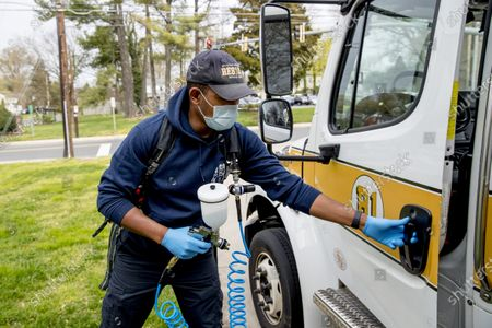 Volunteer EMT Ronald Felix, a full time police officer for Montgomery County, Md., sanitizes an ambulance at Bethesda-Chevy Chase Rescue Squad, in Bethesda, a suburb of Washington