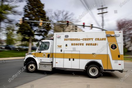 Volunteer first responders go out on a call from Bethesda-Chevy Chase Rescue Squad, in Bethesda, a suburb of Washington