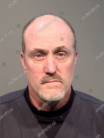 Photo provided by Prescott, Ariz., police shows Keith Brown. Prescott police say Brown, a housekeeping employee, has been fired from his hospital job after being arrested on suspicion of stealing personal protective equipment and cleaning supplies in recent weeks as the coronavirus outbreak unfolded. Lt. Jon Brambila said Brown, 48, was arrested Friday at Yavapai Regional Medical Center on suspicion of one count each of theft and fraud after police found numerous items valued at $1,700 in Brown's vehicle and residence