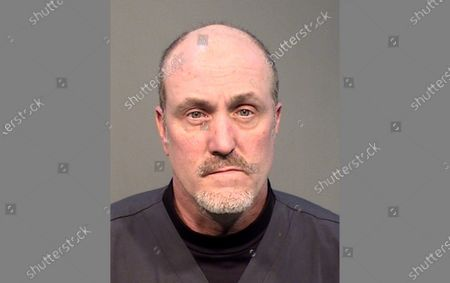 Stock Photo of Photo provided by Prescott, Ariz., police shows Keith Brown. Prescott police say Brown, a housekeeping employee, has been fired from his hospital job after being arrested on suspicion of stealing personal protective equipment and cleaning supplies in recent weeks as the coronavirus outbreak unfolded. Lt. Jon Brambila said Brown, 48, was arrested Friday at Yavapai Regional Medical Center on suspicion of one count each of theft and fraud after police found numerous items valued at $1,700 in Brown's vehicle and residence