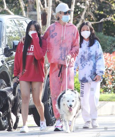 Laeticia Hallyday and children Jade Hallyday Hallyday and Joy Hallyday taking some fresh air protected with masks in Pacific Palisades