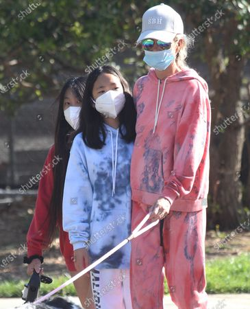 Stock Image of Laeticia Hallyday and children Jade Hallyday Hallyday and Joy Hallyday taking some fresh air protected with masks in Pacific Palisades