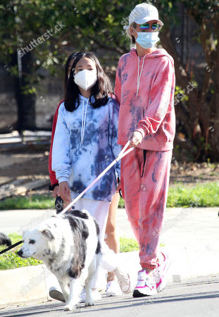 Stock Picture of Laeticia Hallyday and children Jade Hallyday Hallyday and Joy Hallyday taking some fresh air protected with masks in Pacific Palisades