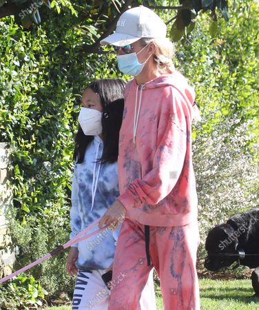 Laeticia Hallyday and children taking some fresh air protected with masks in Pacific Palisades