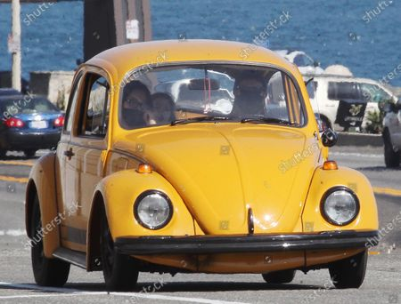 Ewan McGregor and children going for a ride in his old yellow bug in Malibu