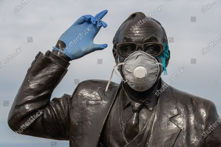 Editorial picture of Masked Eric Morecambe statue, Morecambe, UK - 05 Apr 2020