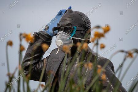 Editorial photo of Masked Eric Morecambe statue, Morecambe, UK - 05 Apr 2020