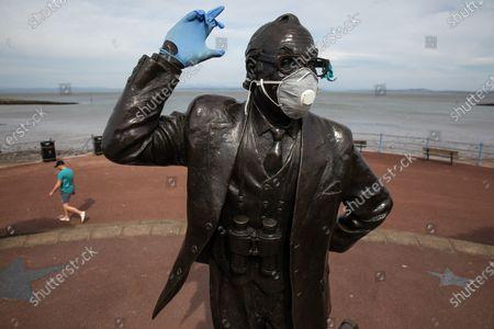 Editorial image of Masked Eric Morecambe statue, Morecambe, UK - 05 Apr 2020