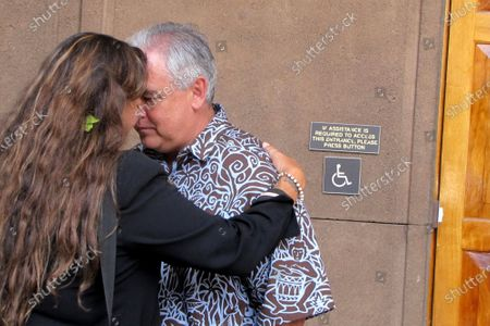 Mike McCartney, center, Gov. David Ige's former chief of staff, greets Mauna Kea telescope opponent Kealoha Pisciotta using honi, a traditional Hawaiian forehead-to-forehead greeting at the Hawaii Capitol in Honolulu. People in Hawaii are changing how they express aloha in the time of coronavirus. Some residents say social distancing is the antithesis of tradition in the state, where people greet each other with hugs, kisses and lei, and families are close-knit