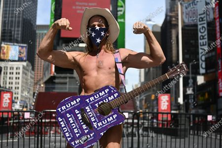 New York The Naked Cowboy, aka Robert John Burck, posing for a photo in an almost empty Times Square.