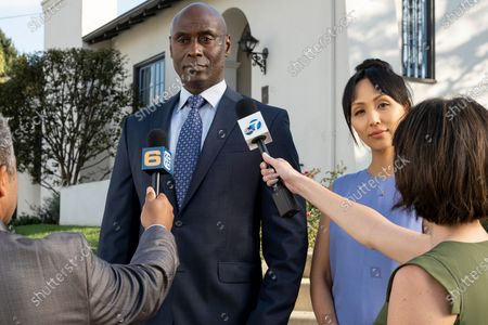 Stock Photo of Lance Reddick as Irvin Irving and Linda Park as Jun Park