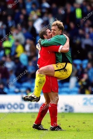 Wycombe Wanderers goalkeeper, Martin Taylor, leaps into the arms of Paul McCarthy at the final whistle to celebrate a 2-1 victory and the league double over Manchester City during Manchester City vs Wycombe Wanderers, Nationwide League Division Two Football at Maine Road on 24th April 1999