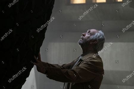 Jonathan Pryce as Russ