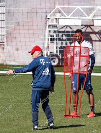 Bayern's assistent coach Hermann Gerland (L) and Bayern's Jerome Boateng in action during a training session at the Club's ground in Munich, Bavaria, Germany, 06 April 2020. Bayern Munich players return to training  for the first time since the Bundesliga campaign was halted by the coronavirus pandemic. The Bundesliga remains suspended until at least 30 April following a meeting of league clubs on 31 March.