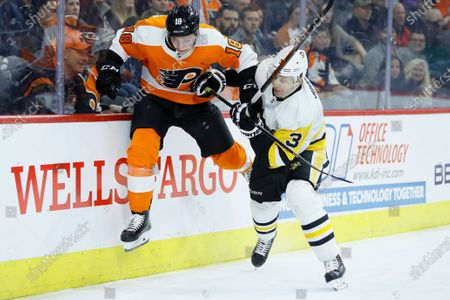 Philadelphia Flyers' Tyler Pitlick, left, tries to jump past Pittsburgh Penguins' Jack Johnson during the second period of an NHL hockey game in Philadelphia. The latest chapter of The Battle of Alberta is on hold. So's the potential renewal of the Pennsylvania rivalry between the Penguins and Flyers. It's unclear when or if the coronvirus pandemic-delayed NHL playoffs -- which were supposed to begin Wednesday -- will be played or what form they'll resemble