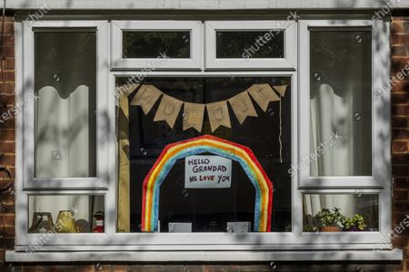 Rainbow drawings in windows with love for Grandad - A 'symbol of hope' inspired by a drawing (pictured) by Sir Peter Blake, the artist who designed the cover of The Beatles' Sgt. Pepper album. The Evening Standard asked Sir Peter to create his version while he is in self-isolation. The 'lockdown' continues for the Coronavirus (Covid 19) outbreak in London.