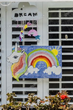 Rainbow unicorn drawings in windows - A 'symbol of hope' inspired by a drawing (pictured) by Sir Peter Blake, the artist who designed the cover of The Beatles' Sgt. Pepper album. The Evening Standard asked Sir Peter to create his version while he is in self-isolation. The 'lockdown' continues for the Coronavirus (Covid 19) outbreak in London.