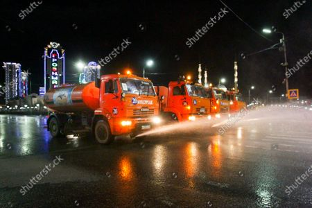 Municipal tankers spray disinfectant as a precaution against the coronavirus, on a street in the center of Grozny, Russia, . Ramzan Kadyrov, strongman leader of Russia's province of Chechnya, has taken extreme measures to fight the spread of the new coronavirus in the region, vowing Monday not to let anyone who is not a formal resident of Chechnya into the area.The new coronavirus causes mild or moderate symptoms for most people, but for some, especially older adults and people with existing health problems, it can cause more severe illness or death