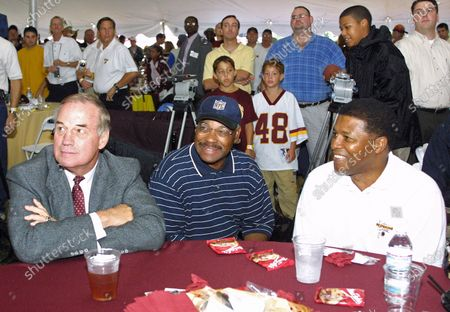 Stock Image of On the eve of the Washington Redskins' final preseason game, the Redskins Alumni Association and the Redskins Development Corporation put on a gala Welcome Home Luncheon at Redskin Park in Ashburn, Virginia. More than 500 fans, alumni and supporters attended the picnic style cook out which was held in a huge tent due to needed rain in the drought stricken area. As the rain fell players were honored, signed autographs and a good time was had by all. Redskin Alumni, pictured from left to right: Sam Huff, Hall of Fame linebacker; Bobby Mitchell, Hall of Fame wide receiver; and Brig Owens, defensive back.