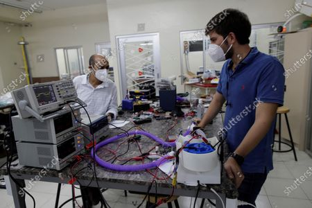 Doctor in Mechanical Engineering, Humberto Rodriguez (L), works with a student from the Technological University of Panama (UTP), on a prototype of a humidifier for people affected by COVID-19, in Panama City, Panama, 06 April 2020. The high-flow humidifier is a system used to treat the air of patients with COVID-19 and is considered an additional palliative for the care of those hospitalized with difficulty breathing.